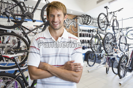 store manager in bicycle shop smiling