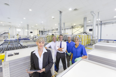 factory employee team smiling at camera