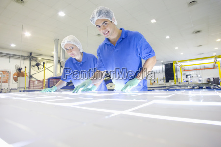 technician worker smiling at camera arranging