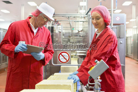 quality control workers with digital tablet