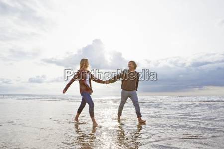 couple walking and holding hands in