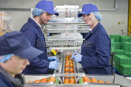 portrait smiling quality control worker inspecting