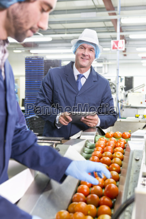 portrait confident quality control worker with