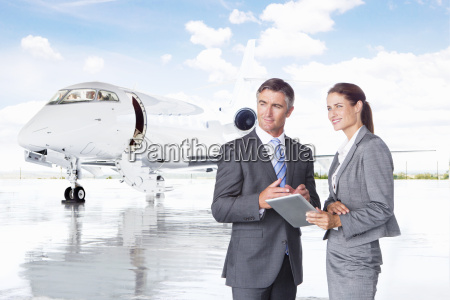 businesswoman and businessman with digital tablet