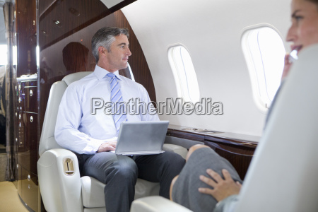 businesswoman on phone and businessman with