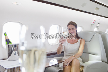 attractive woman sitting and holding champagne