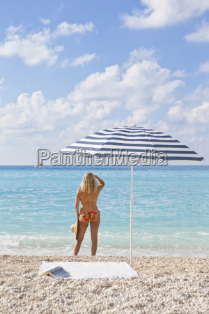 woman in bikini on beach looking