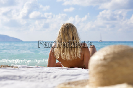 woman laying on blanket on sunny