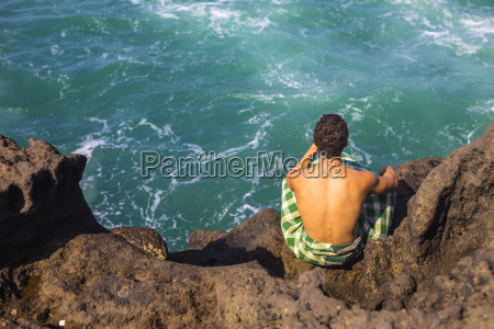 young man near the oceanbaliindonesia