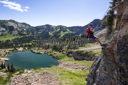 a women completes a rock climb