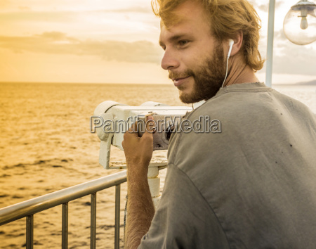 young man at cruise deck ship