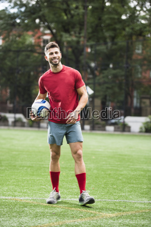 guy playing soccer in field in