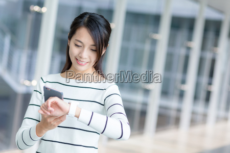 woman using cellphone and connecting with