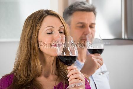couple tasting glass of wine
