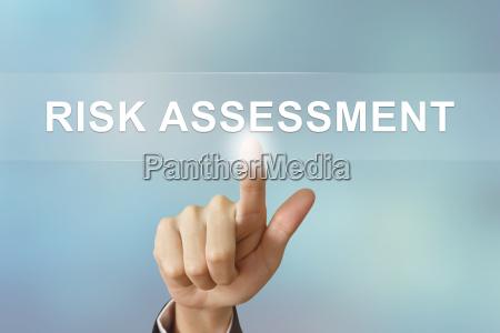 business hand clicking risk assessment button