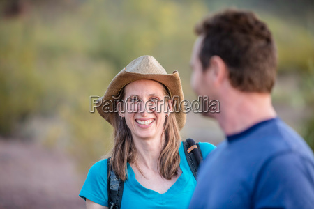 smiling woman on nature hike