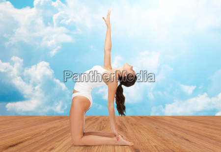woman in cotton underwear doing yoga
