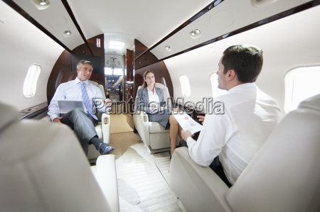 businessmen and businesswoman with digital tablet