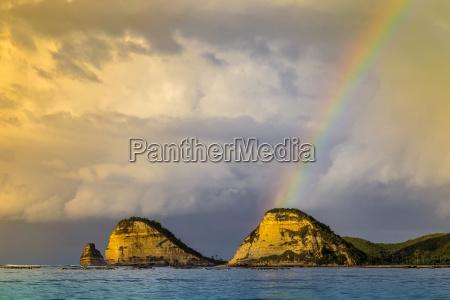 rainbow above an ocean