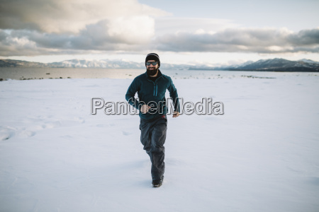 a man running in the snow