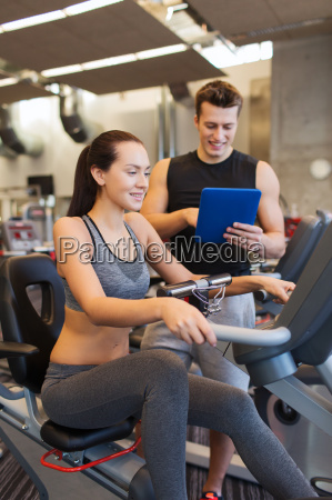 happy woman with trainer on exercise
