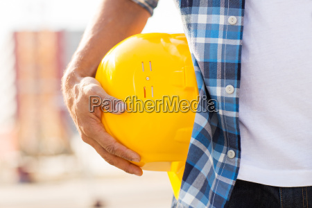 close up of builder hand holding