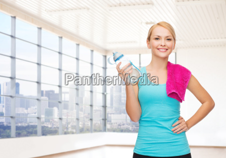 happy woman with bottle of water