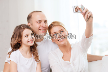 happy family with little girl making