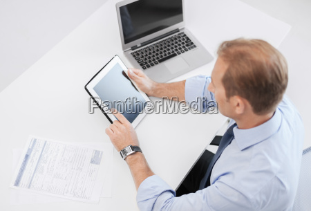 businessman with tablet pc and papers