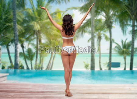 woman in white bikini swimsuit on