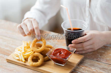 close up of woman with snacks