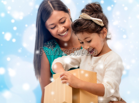 happy mother and child girl with