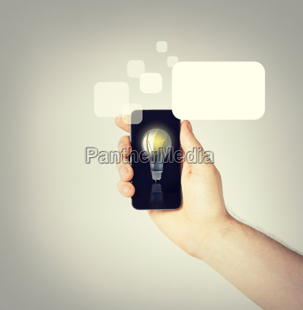 man hand holding smartphone with light