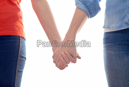 close up of lesbian couple holding