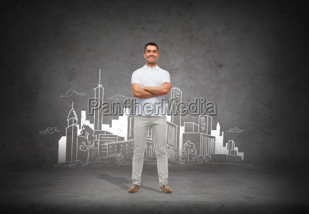 smiling man over city sketch background