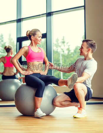 smiling man and woman with exercise