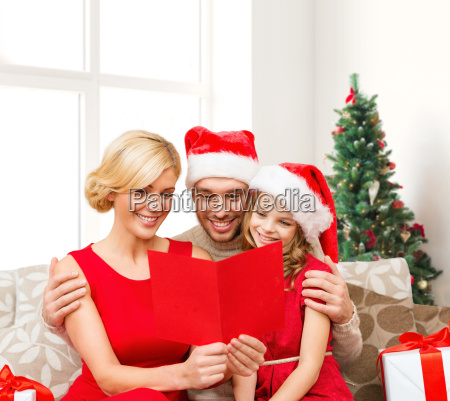 happy family in santa hats with