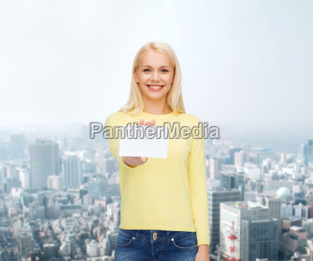 smiling girl with blank business or