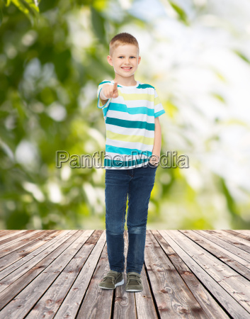 smiling little boy pointing finger at
