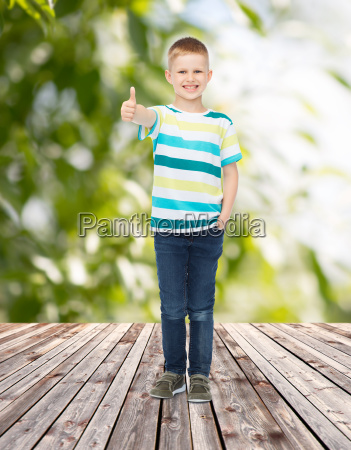 smiling little boy showing thumbs up