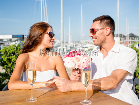 smiling couple with bunch and champagne