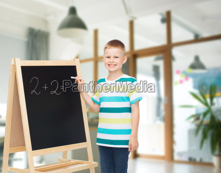 happy little boy with blackboard and