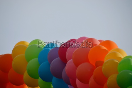 a bunch of colorful balloons