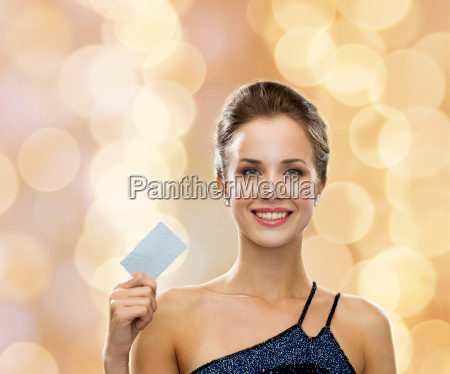 smiling woman in evening dress holding