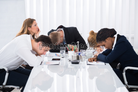 businesspeople sitting in business meeting