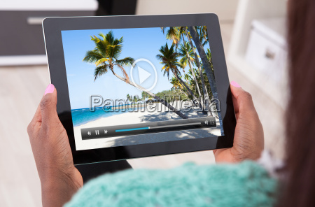 woman holding digital tablet at home
