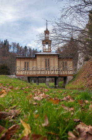 old wooden chapel on water in