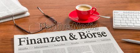 newspaper on desk finances and