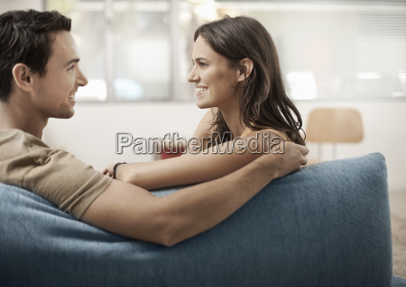 a young couple sitting on a
