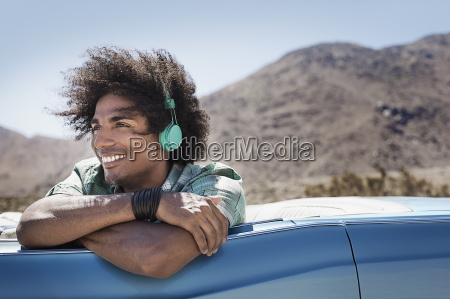 a young man with music headphones